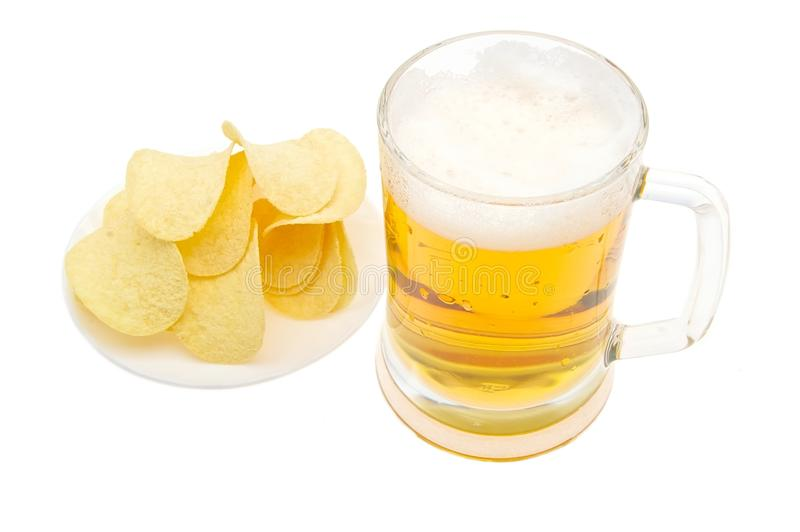 Beer with chips. Isolated on white royalty free stock images