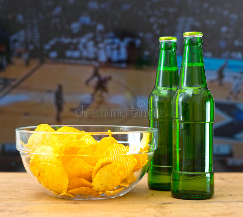 Beer and chips. stock image