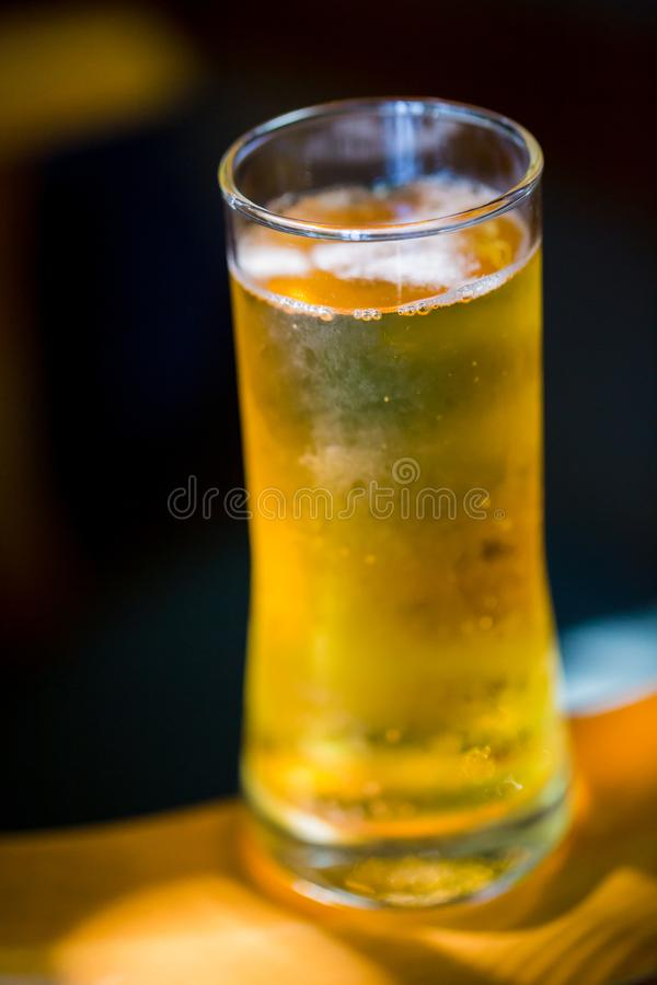 Beer. Cold Craft light Beer in a glass with water drops royalty free stock image