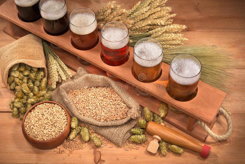 Beer crate with beer glasses. Beer crate with many different beers, hops, wheat, grain, barley and malt stock photo