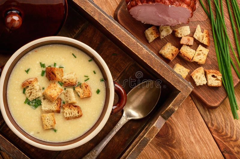 Beer cream soup with chicken fillet, ham and cheese. Beer cream soup with chicken fillet, ham and cheese stock images