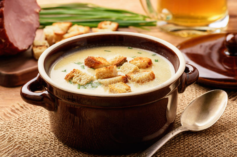 Beer cream soup with chicken fillet, ham and cheese. Beer cream soup with chicken fillet, ham and cheese stock photo