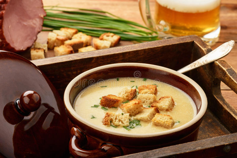Beer cream soup with chicken fillet, ham and cheese. Beer cream soup with chicken fillet, ham and cheese stock image