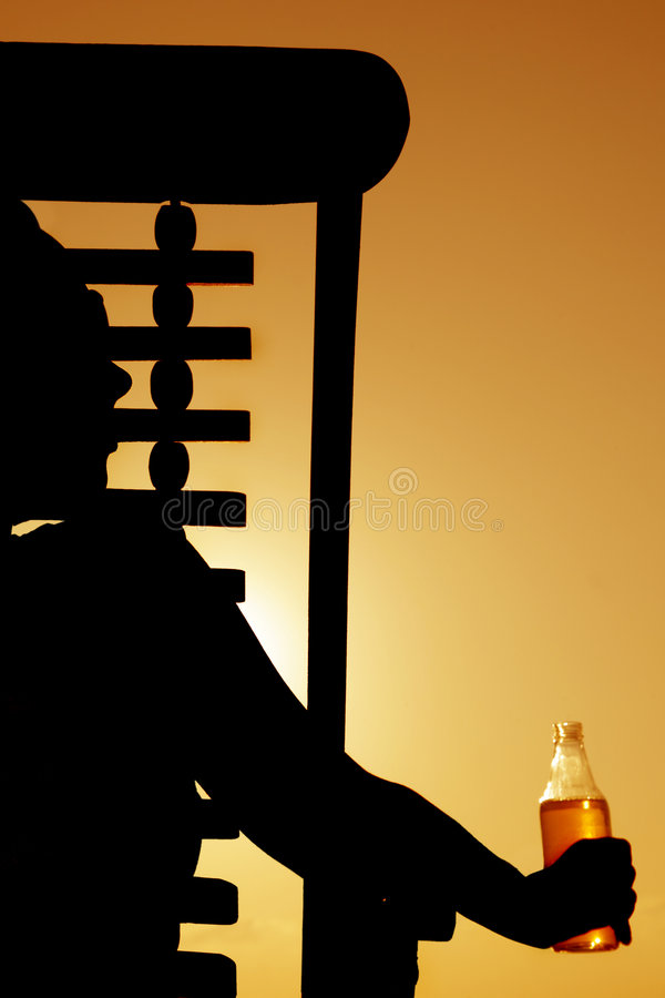 Beer and Deckchair sunset silhouette stock images