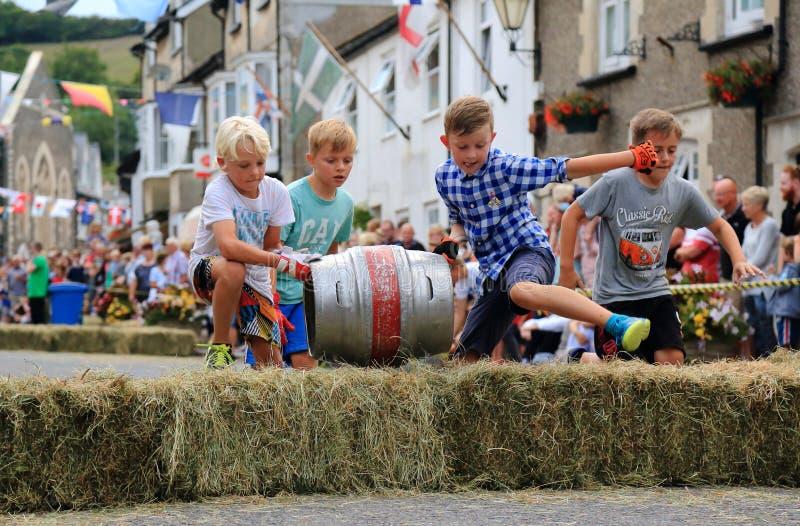 Barrel rolling race. Beer, Devon, UK.14th August 2018: Famous barrel rolling race in main street of Beer during annual Beer Regatta Week event. Four members of