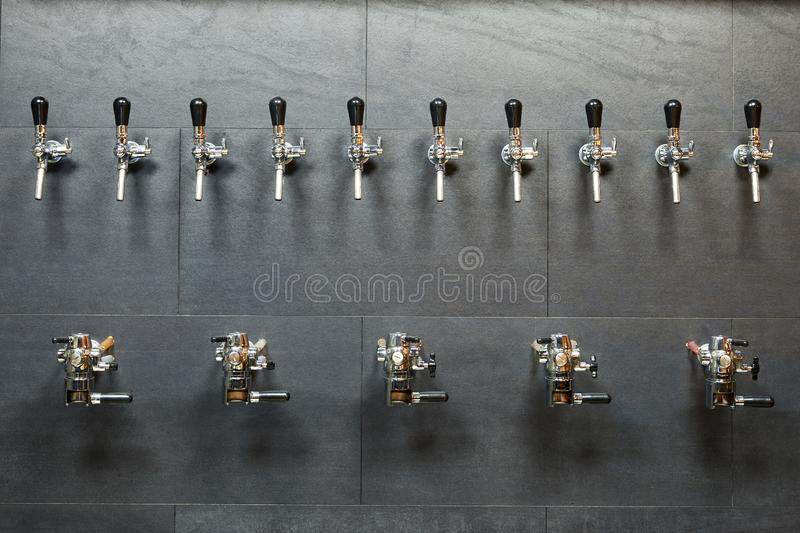 Beer equipment for beer bottling. In a row royalty free stock image