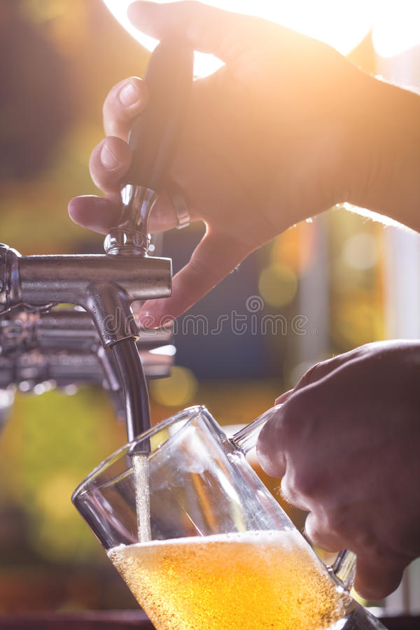 Beer filling up stock photos