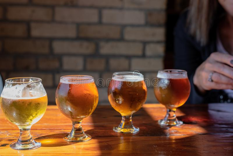 Beer flight on rustic wood table stock images