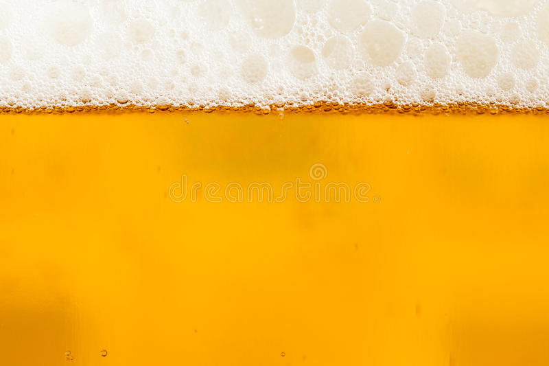 Beer with foam in the glass royalty free stock photography