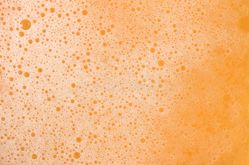 Beer foam texture. Beer foam texture close up as background royalty free stock photography