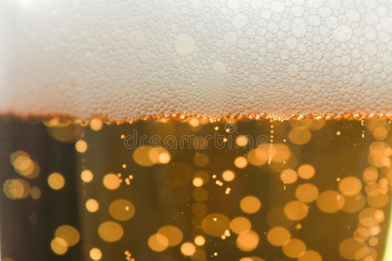 Beer and foam texture on whole background stock photography