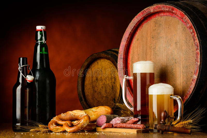 Beer and food on rustic background stock photography