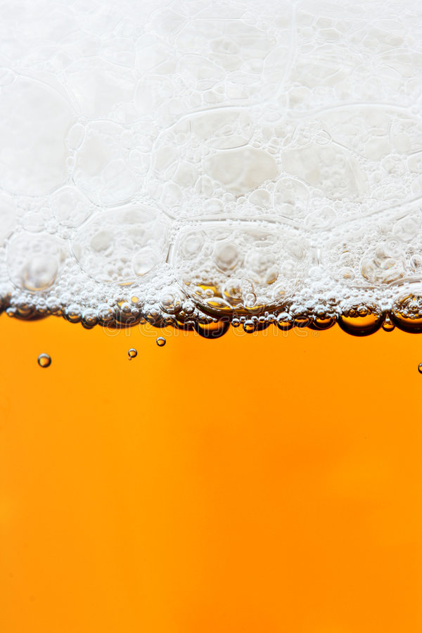Beer and froth. Close-up, may be used as background stock photography