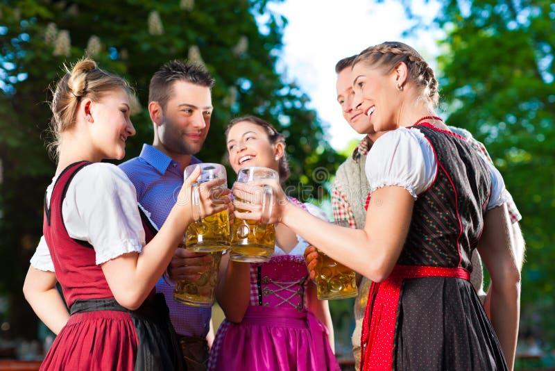 In Beer Garden - Friends Drinking Beer Royalty Free Stock Photography
