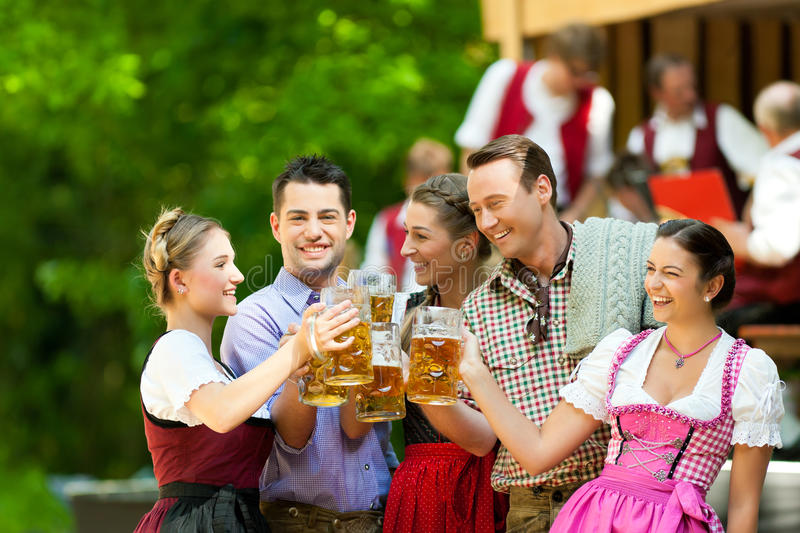 In Beer Garden - Friends In Front Of Band Royalty Free Stock Images