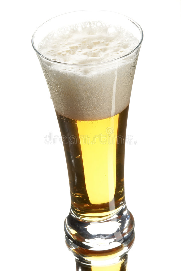 Beer in glass. On the white background royalty free stock photography
