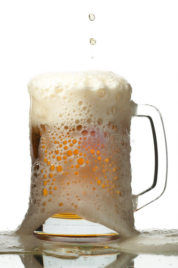 Beer in glass stock photo
