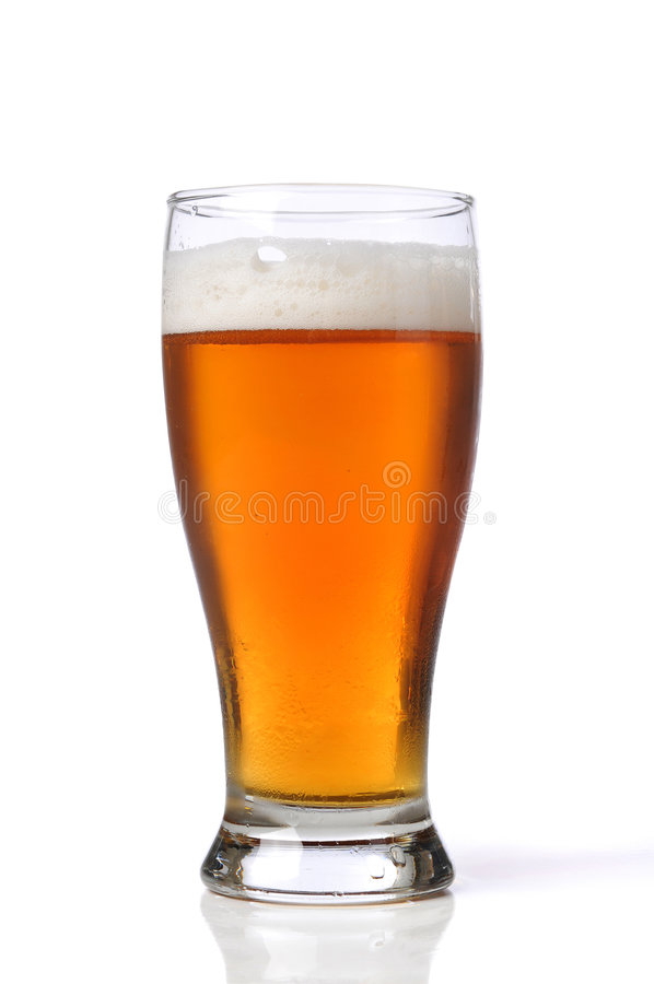 Beer on a glass. Isolated against a white background stock photo