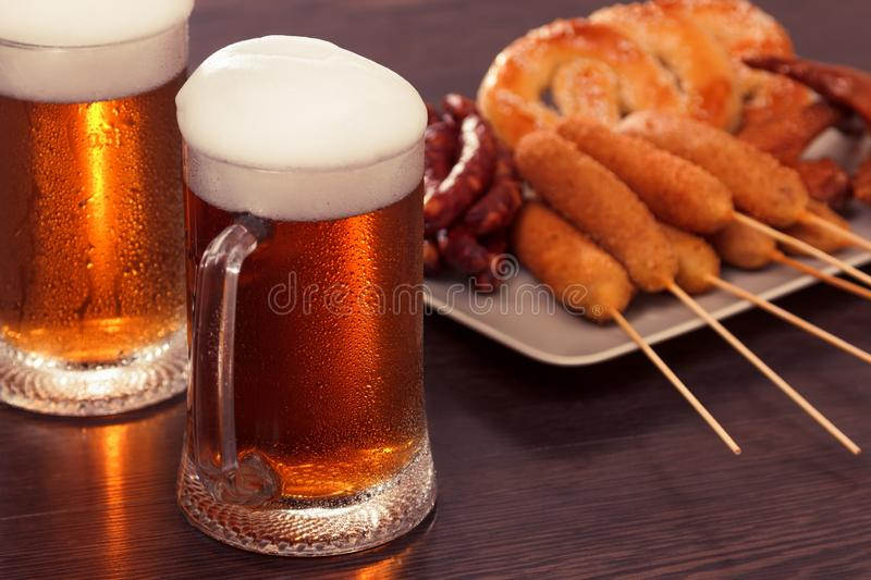 Beer glass alcohol drink with food sausage,  grilled bar stock photography