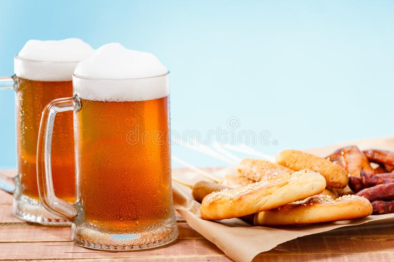 Beer glass alcohol drink with food sausage,  meal royalty free stock images