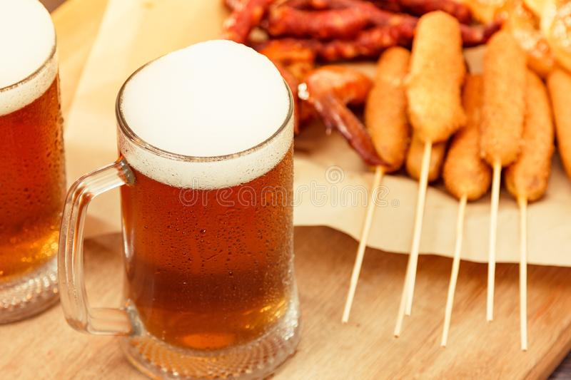Beer glass alcohol drink with food sausage,  pub view royalty free stock images