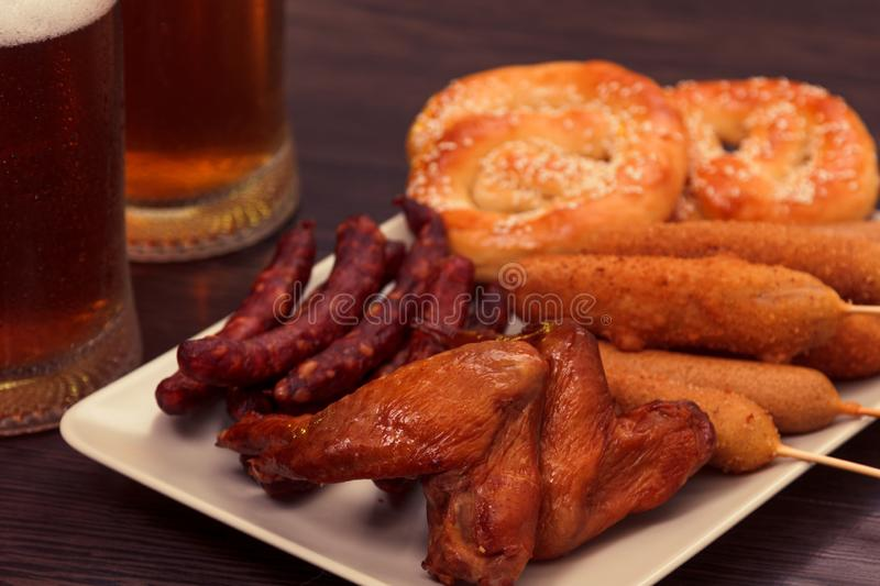 Beer glass alcohol drink with food sausage,  pub bar royalty free stock image