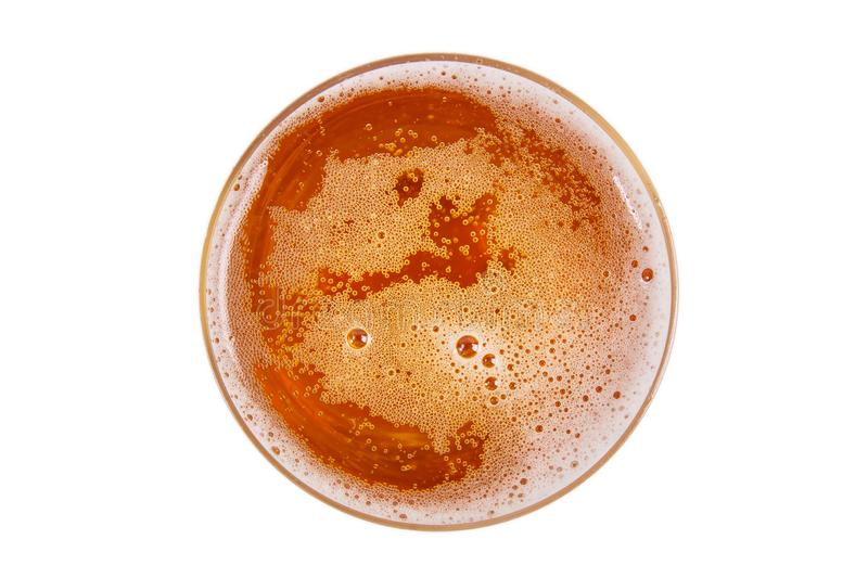 Beer in glass. Beer foam. View from above royalty free stock image
