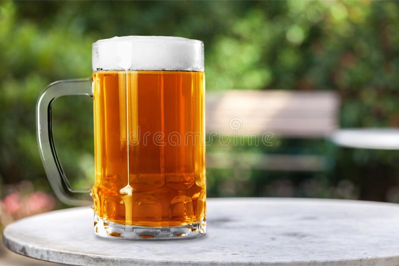 Beer glass. Pouring drunk cold alcohol royalty free stock photos