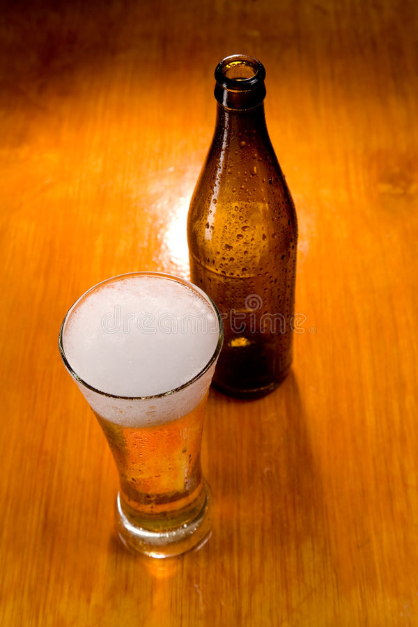 Beer glass and bottle. Selective focus stock image