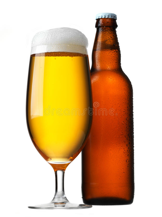 Beer glass and bottle. Isolated on white royalty free stock image