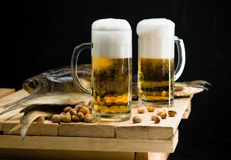 Beer in a glass with a beautiful foam royalty free stock photo