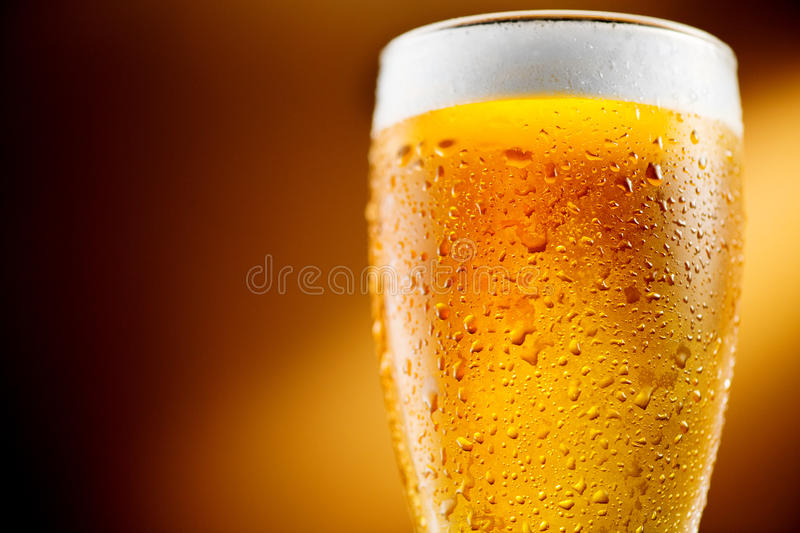 Beer. Glass of cold craft beer royalty free stock photography
