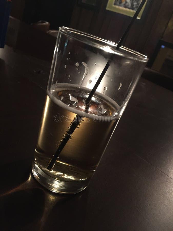 Beer glass. Dark low key bar royalty free stock photo