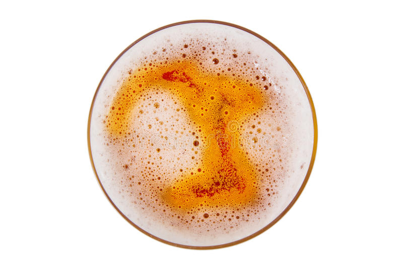 Beer in glass with foam. stock images