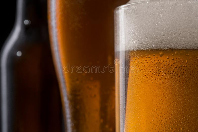Beer glass in macro view stock images
