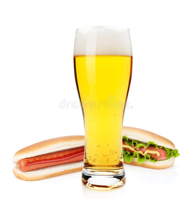 Beer glass and two hot dogs with various ingredients. Isolated on white background royalty free stock photos
