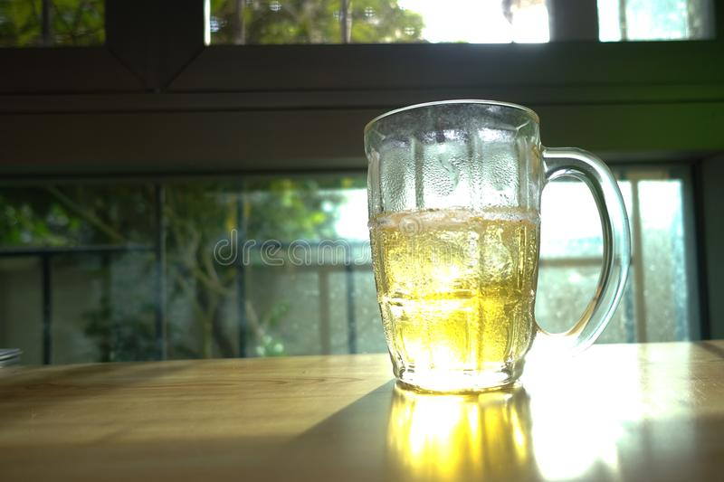 Beer Glass. On Wood Table stock image