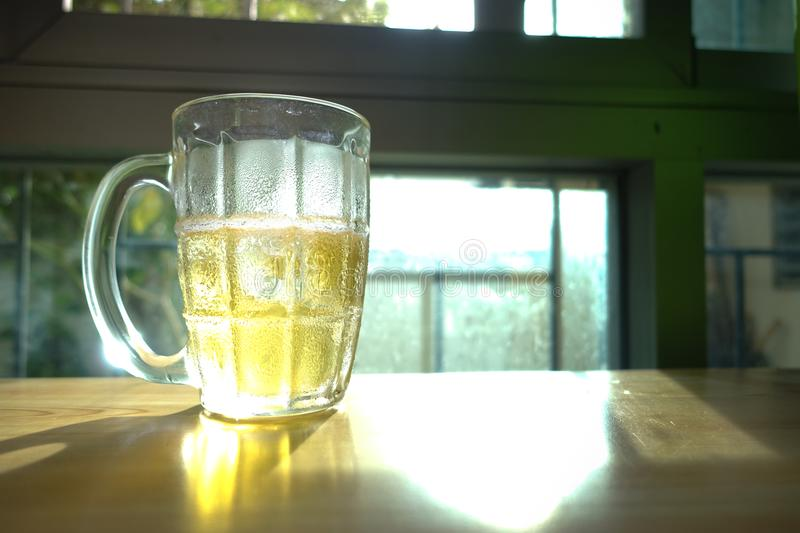 Beer Glass. On Wood Table stock photos