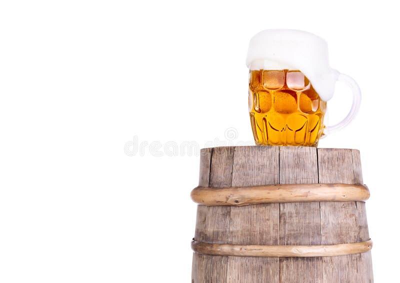 Beer glass on wooden vintage barrel stock image