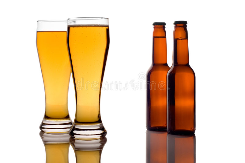 Beer glasses and bottles stock photography