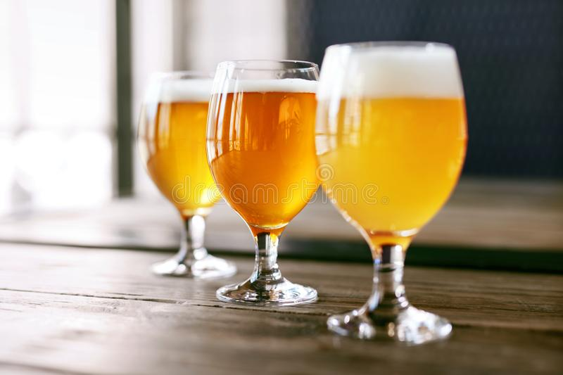 Beer Glasses On Wooden Table Closeup stock image