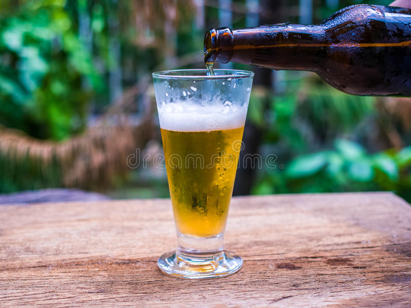 Beer glass on wood background. Beer glass on vintage wood background stock photography