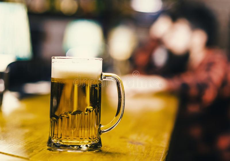 Beer in the grocery. Glass with fresh lager draft beer with foam, close up. Glass filled with cold tasty beer in pub royalty free stock image