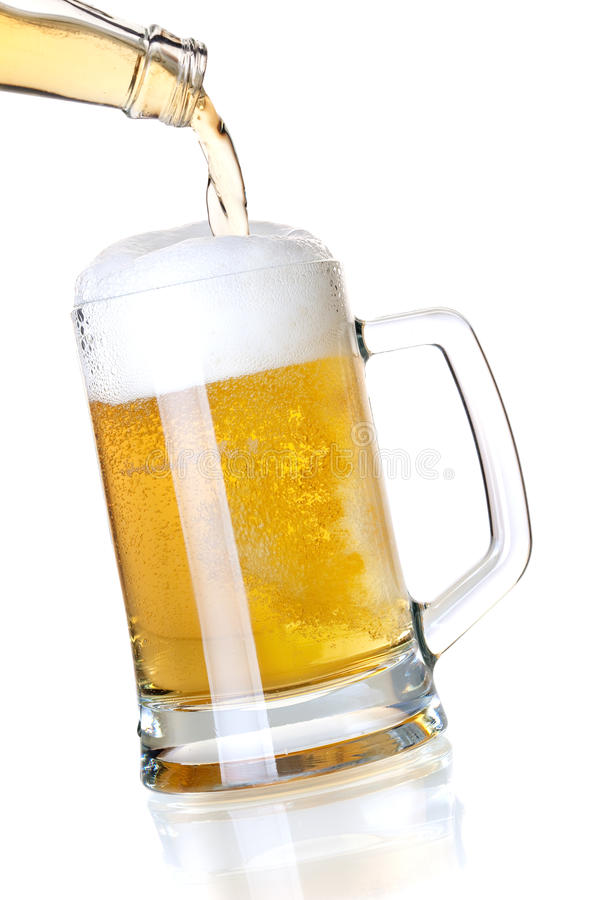 Beer with head is pouring into a glass from bottle. Beer collection - Lager beer with head is pouring into a glass from bottle stock photos