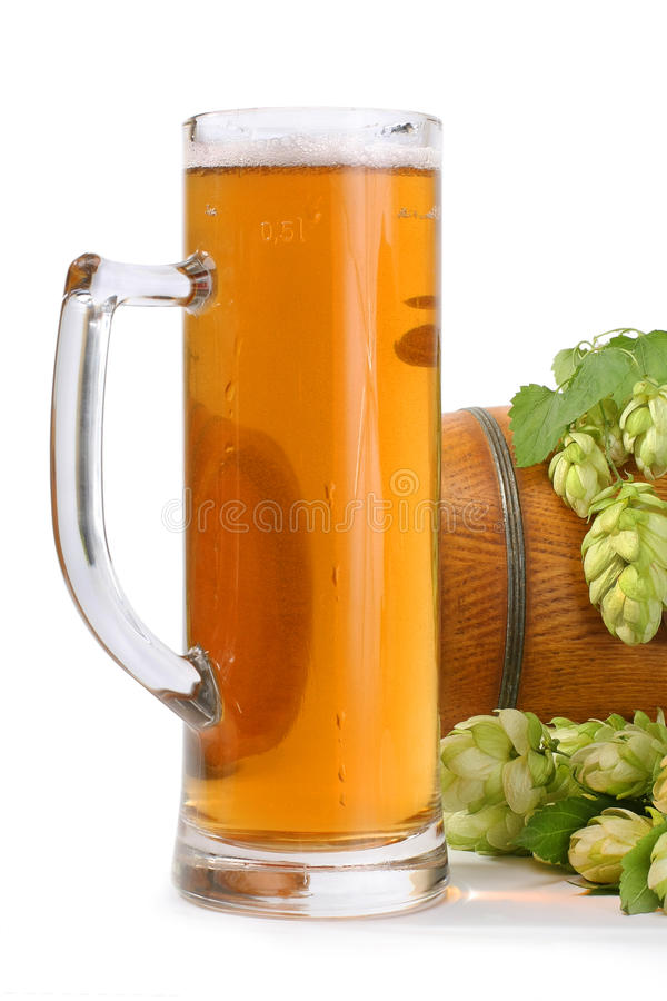 Beer with hops. A glass and a barrel of beer with hops flowers stock photos