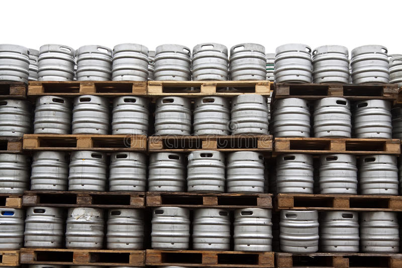 Beer kegs over white. Beer kegs in rows over white background stock images