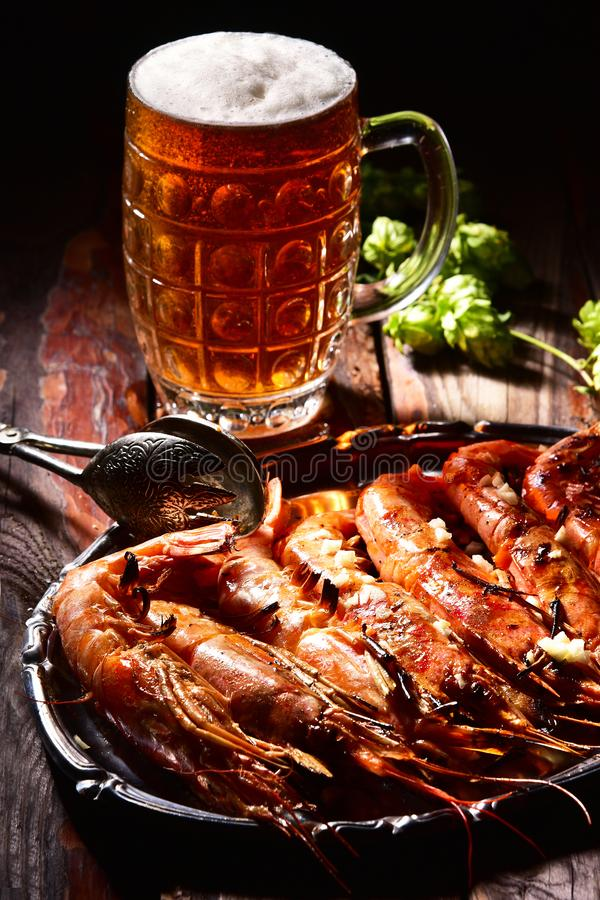 Beer and langoustines on a dark background. stock image