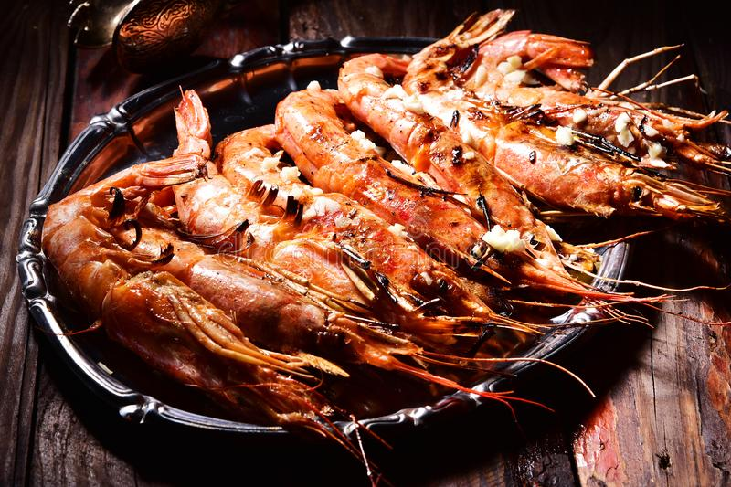 Beer and langoustines on a dark background. stock photo