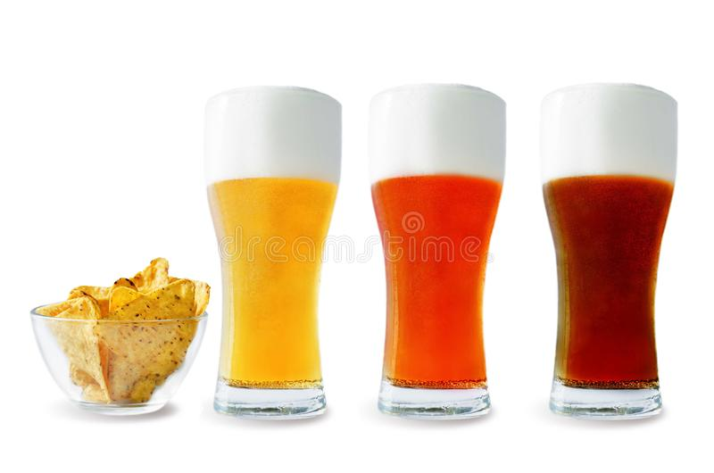 Beer list: light, red and dark beers with corn chips. On a white background. toning. selective focus royalty free stock photos