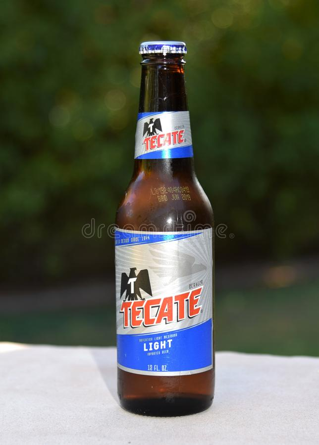 Bottle of Tecate beer imported from Mexico. Beer manufactured in Mexico exported to the United States. Free trade agreement keeps from tariffs stock photography